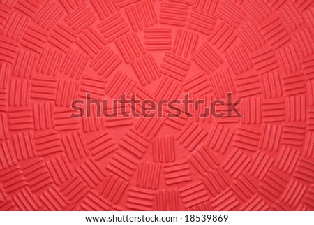 A close up of a new dodge ball shows the unique gripping patterns engineered into the ball's design. - stock photo