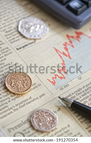 A close up of a newspaper showing the performance of shares on the stock market. - stock photo