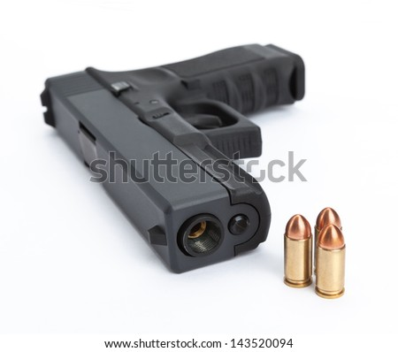 A close-up of a pistol and ammo isolated on a white background