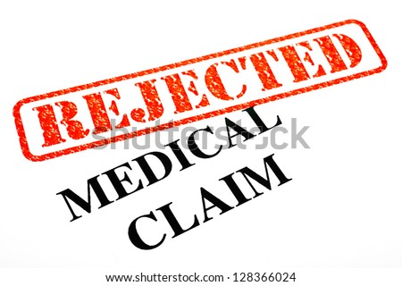 A close-up of a REJECTED Medical Claim. - stock photo