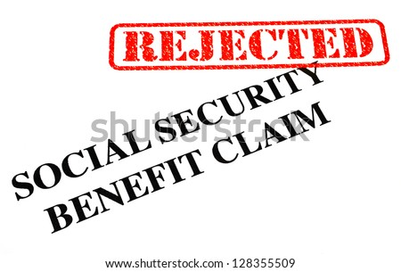 A close-up of a REJECTED Social Security Benefit Claim document.