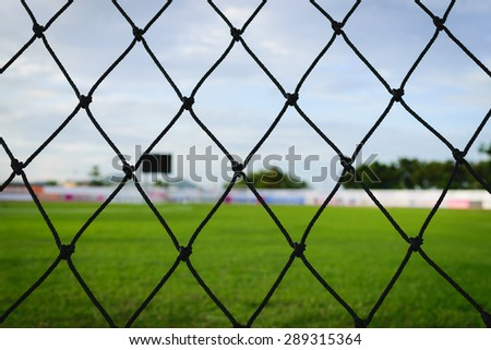 A close up of a soccer net - stock photo