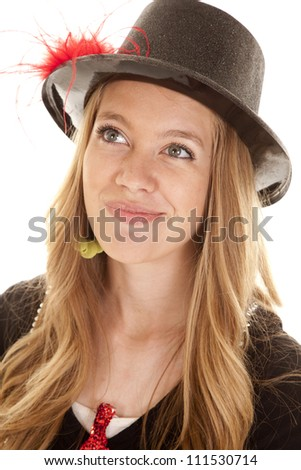 a close up of a teen girl in her top hat with a small smile on her face. - stock photo