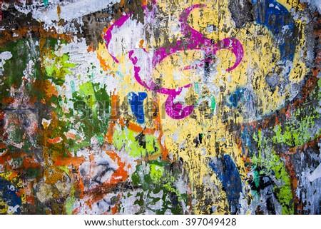 A close-up of a vibrant multi colored graffiti wall. - stock photo