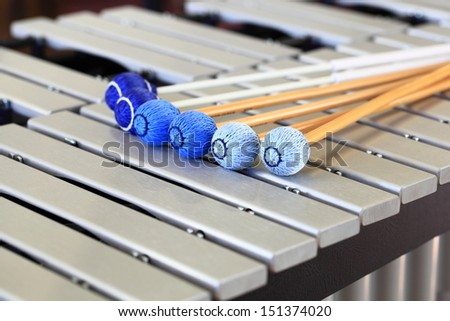A close up of a vibraphone keyboard and mallets. - stock photo