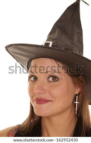 A close up of a witch wearing a hat and smiling.