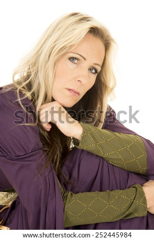 A close up of a woman curled up in her vintage dress. - stock photo