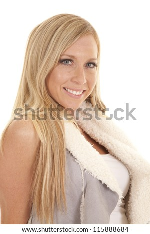 A close up of a woman in her gray vest with a smile on her face. - stock photo