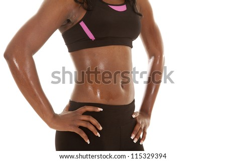 A close up of a woman's body wet with sweat. - stock photo