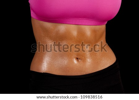 a close up of a woman's stomach with sweat dripping off of it