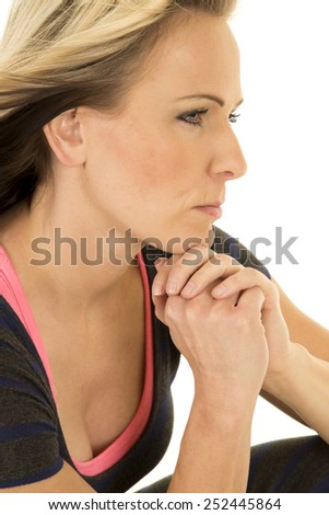 a close up of a woman with a serious expression on her face deep in thought. - stock photo