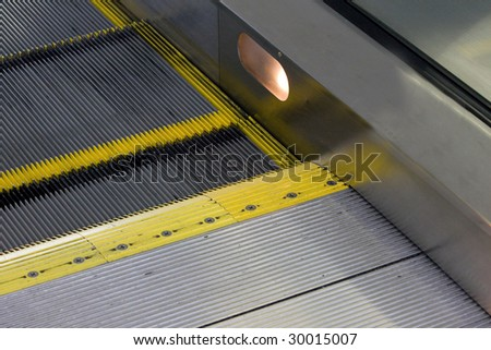 a close up of an escalator - stock photo