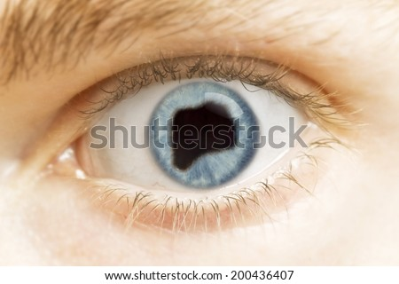 A close-up of an eye with the pupil in the shape of Rwanda.(series)