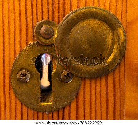 A Close Up Of An Old Brass Key Hole With Brass Cover Open To See Through