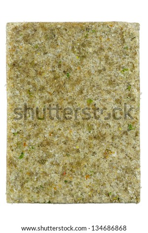 A close-up of beef flavored bouillon (stock) cube isolated on a white background - stock photo