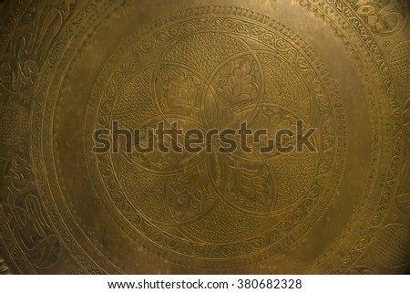 A close up of big antique metal plate. - stock photo