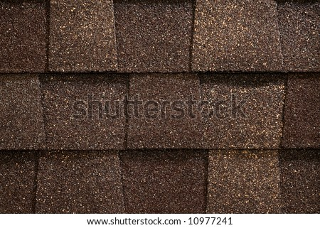 A Close Up Of Brown Toned Architectural Style Asphalt Roofing Shingles.