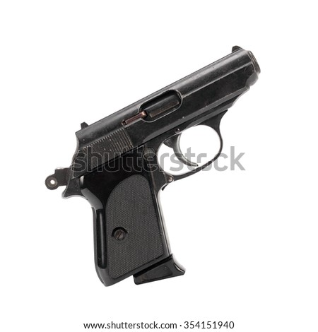 A close up of cocking a black handgun. The bullet can be seen inside the gun. It is isolated, the worker of paths is present. - stock photo