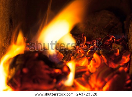 A close-up of glowing wood embers for barbecue  - stock photo