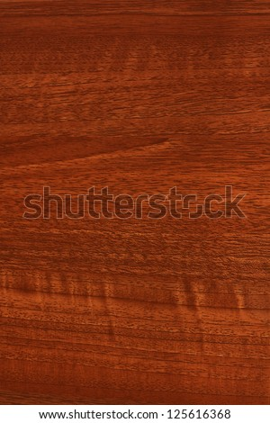 A close up of mahogany, teak or stained wood grain for website wallpaper or background - stock photo