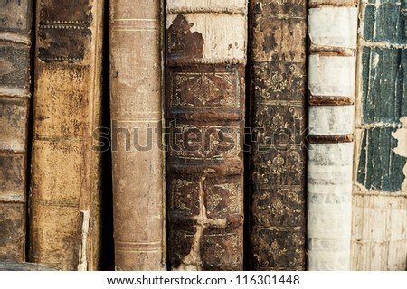 A close up of many old books - stock photo