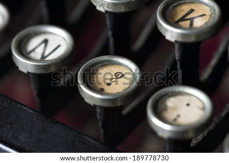 A close-up of question mark key on an old typewriter