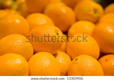 A close-up of ripe organic navel oranges - stock photo