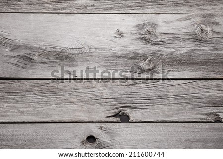 A close up of several planks of vintage barnboard. - stock photo