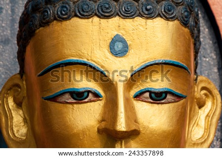 A close up of the eyes of a huge buddha in Nepal. - stock photo