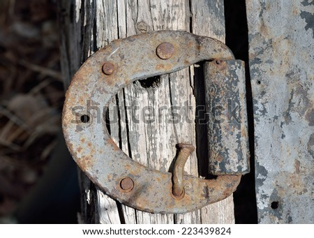 A close up of the old iron door-hinge. - stock photo