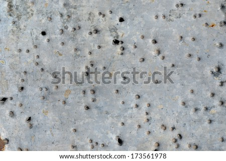 A close up of the surface of metal after shot with shotgun. - stock photo