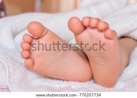 A close-up of tiny baby feet