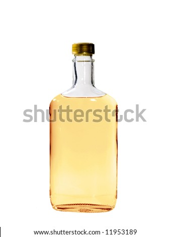 A close up on a bottle of Tequila isolated on a white background. - stock photo
