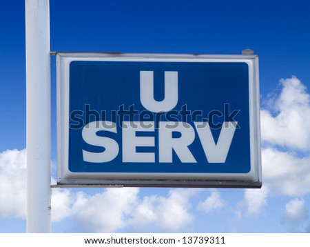 A close up on a sign with the words U SERV.