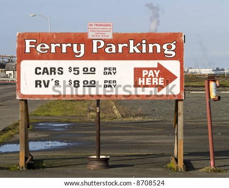 A close up on an old Ferry Parking sign.