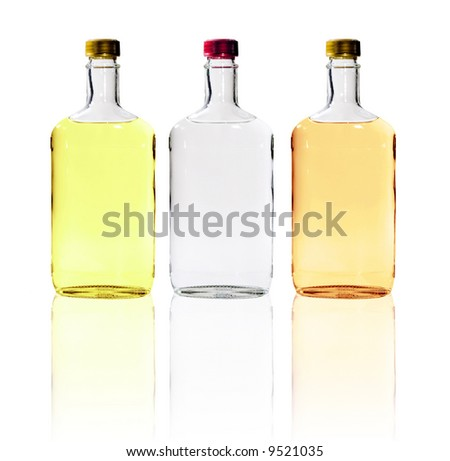 A close up on bottles of alcohol isolated on a white background.