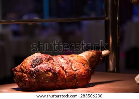A Close up on roast lamb leg.  - stock photo