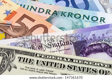 A close-up photograph of  Swedish, United States and Euro currency. - stock photo