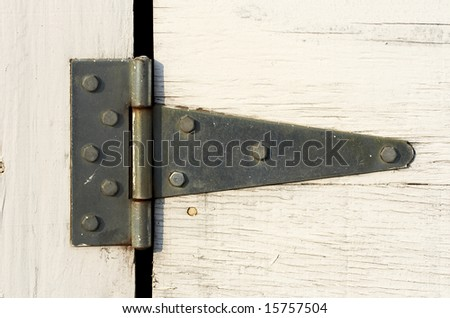 a close up picture of hinge on door - stock photo