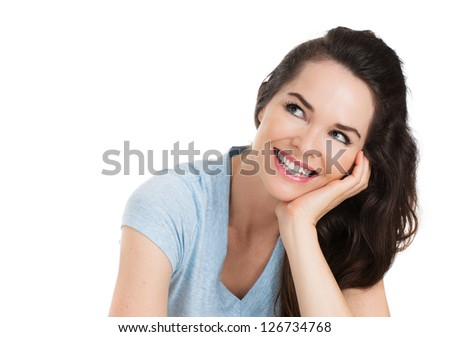 A close-up portrait of a beautiful happy smiling woman looking up at copyspace. Isolated on white. - stock photo