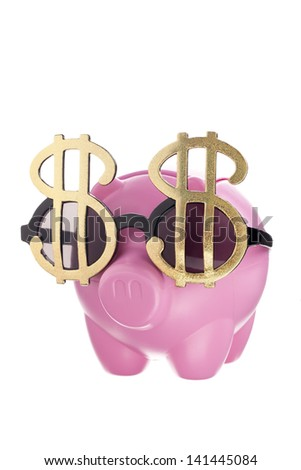 A close-up portrait of a pink piggy bank with a dollar shape design shades isolated on white - stock photo