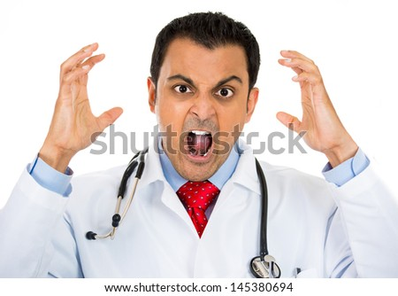 A close-up portrait of a rude, frustrated, upset doctor isolated on a white background  - stock photo