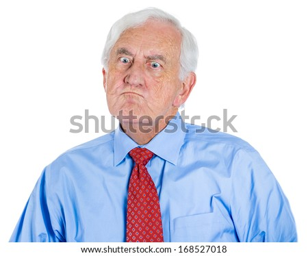 A close-up portrait of a very displeased senior executive, old corporate employee, grandfather, isolated on a white background with copy space. Human emotions. Conflict situation. Facial expression. - stock photo