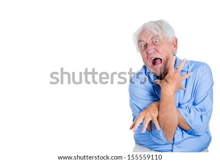 A close-up portrait of an elderly, desperate, mad, looking crazy, desperate man, going insane, isolated on a white background with copy space. Human emotions extremes. Loneliness, mental health
