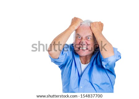 A close-up portrait of an elderly, mad, crazy looking, desperate man, pulling out his hair in despair isolated on a white background with copy space. Human emotions extremes. Family loss, grief. - stock photo