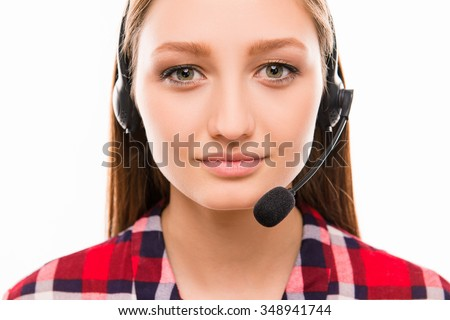 A close-up portrait of pretty  assistant of call centre - stock photo