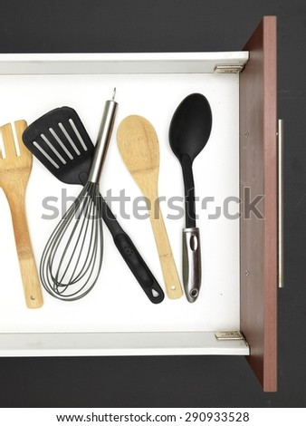 A close up shot a cutlery draw - stock photo
