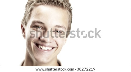 A close-up shot of a boy smiling, isolated on white. - stock photo
