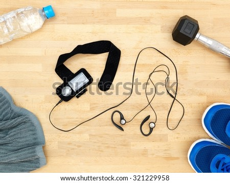 A close up shot of a conceptual gym workout items - stock photo