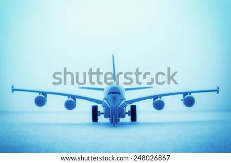 A close up shot of a die cast model plane selective DOF, abstract background, blue toning.